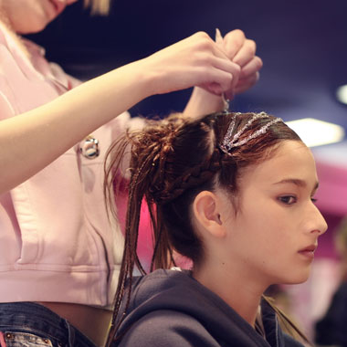 Girl Getting Hair Extensions Sewn In